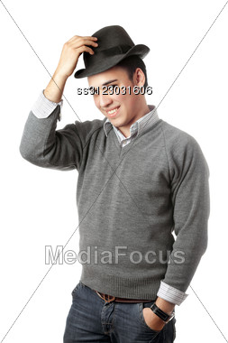 Smiling Attractive Young Man Wearing Black Hat. Stock Photo