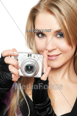 Smiling Beautiful Blonde Holding A Photo Camera. Stock Photo