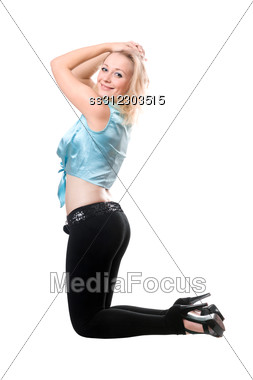 Smiling Blond Lady Bending The Knee. Stock Photo