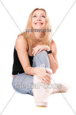 Smiling Blonde In White Fluffy Boots. Stock Photo