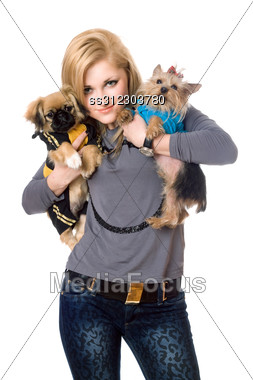 Smiling Blonde Posing With Two Dogs. Stock Photo
