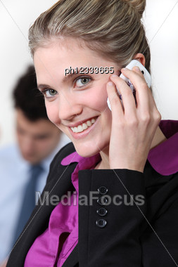 Smiling Businesswoman Taking On Her Mobile Phone Stock Photo