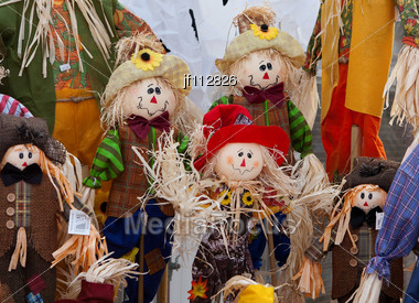 Smiling Handmade Cloth Scarecrow Dolls Displayed Together Stock Photo