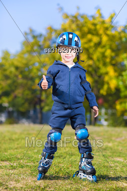 Smiling Little Skater Boy Showing Thumb Gesture Stock Photo