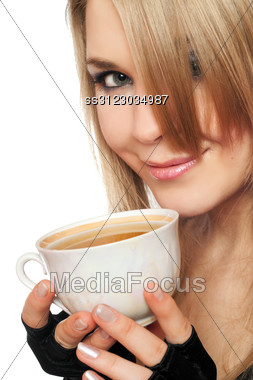 Smiling Lovely Young Blonde With A Cup Of Tea. Stock Photo