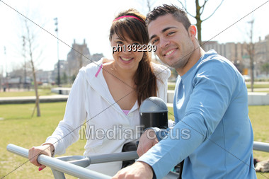 Smiling Man And Woman Relaxing Outdoors Stock Photo