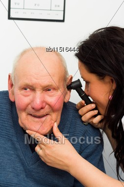 Smiling Patient Enjoying Hearing Examination With Otoscope Stock Photo