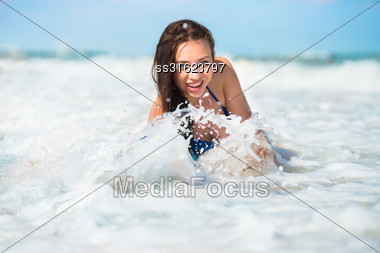 Smiling Playful Brunette Posing In The Water Stock Photo