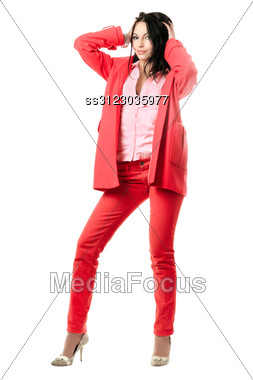 Smiling Playful Young Brunette In Red Suit. Stock Photo