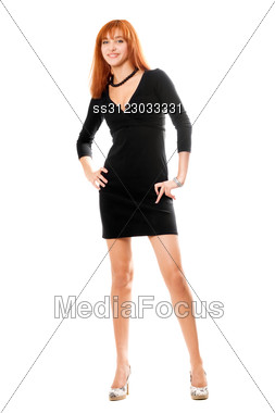 Smiling Red-haired Young Woman In Black Dress Stock Photo