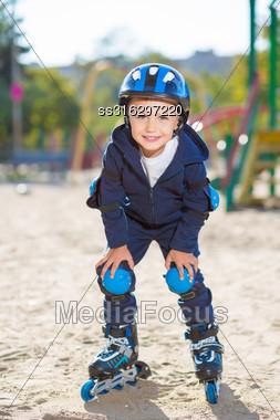 Smiling Skater Boy Posing On The Playground Stock Photo
