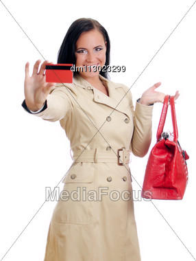 Smiling Woman With Red Credit Card And Bag. Isolated On White. Stock Photo