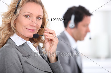 Smiling Woman With Headset Stock Photo