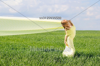 Smiling Young Woman Wrapped In Yellow Cloth Stock Photo