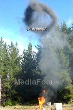 Smoke Ring From Flare Burning Off Gas And Oil At Niagara 1 Oil Well, West Coast, South Island, New Zealand Stock Photo