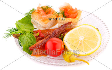 Smoked Fish With Fresh Vegetables On Plate Stock Photo
