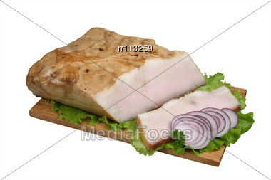 Smoked Lard With Onion And Lettuce On Wooden Board Stock Photo