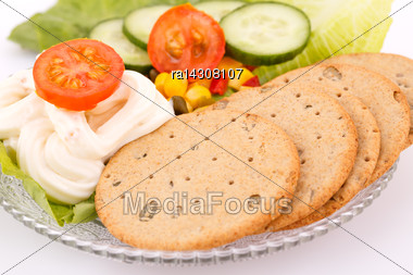 Snack With Vegetables And Crackers On Plate Stock Photo