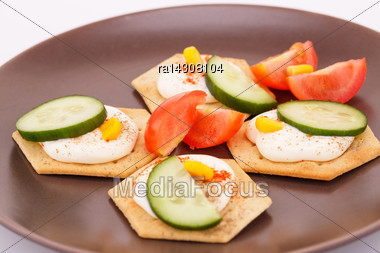 Snacks With Vegetables And Cheese Cream On Brown Plate Stock Photo