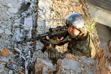 Sniper With A Machine Gun In An Ambush Stock Photo