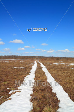 Snow Road On Yellow Herb Stock Photo