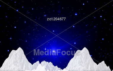 Snow Tops Against The Dark Blue Star Sky Stock Photo