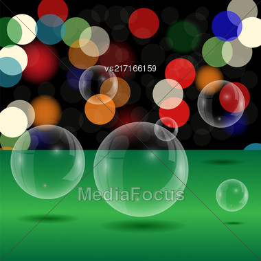 Soap Bubbles On Blurred Lights Background. Green Table And Transparent Bubbles Stock Photo