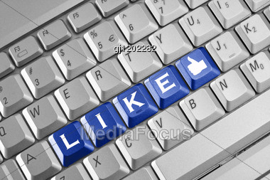 Social Network Concept . Keyboard With Blue Like Button. Stock Photo