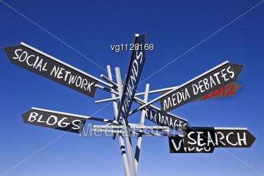 Social Networking Conceptual Directional Post Over Blue Sky Stock Photo