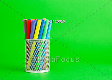 Socket With Colorful Felt Pens Over Green Background Stock Photo