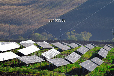 Solar panels in country field Stock Photo