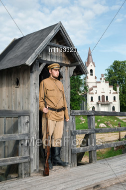 Soldier Armed With A Gun Standing At Sentry. Costume Accord The Times Of World War I. Photo Made At Cinema City Cinevilla In Latvia Stock Photo