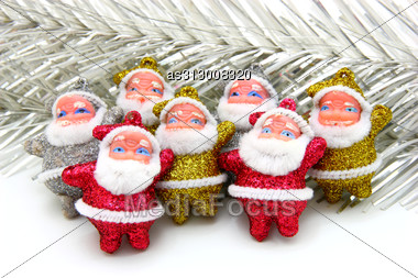 Some Dolls Of Santa Claus Are Together Isolated Stock Photo