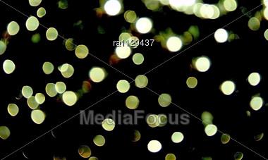Sparkling Spots On Black Background Stock Photo