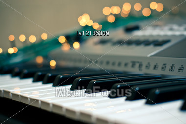 Sparks Of Light Around The Keyboard Of Synthesizer Stock Photo