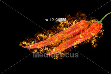 Spicy Red Chilli Peppers At Fire On Black Background Stock Photo