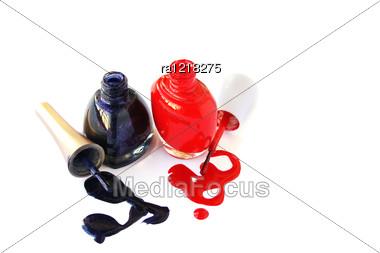 Spilled Nail Polishes Isolated On White Background. Stock Photo