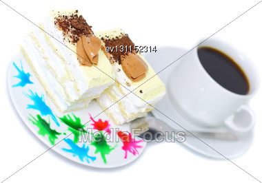 Sponge Cake And On Original Decorating Plate With Cup Of Coffee. Isolated Stock Photo
