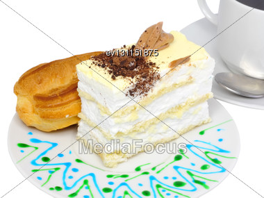 Sponge Cakes And Eclair Cake On Plate With Fruit Juice Spots. Isolated Stock Photo
