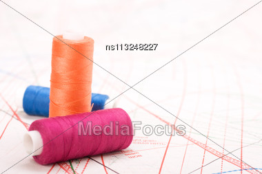 Spool Of Thread. Sew Accessories On Blurred Background Stock Photo