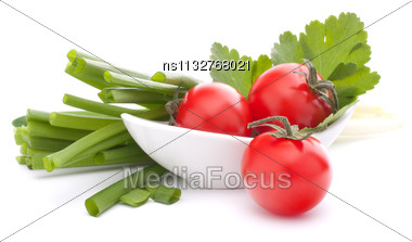 Spring Onions And Cherry Tomato In Bowl Isolated On White Background Cutout Stock Photo