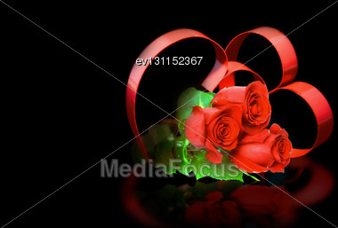 St. Valentine Day. Intertwining Of Two Hearts, On Black Background With Red Roses Stock Photo
