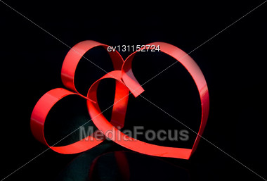 St. Valentine Day. Two Hearts, On Black Background With Reflection Stock Photo