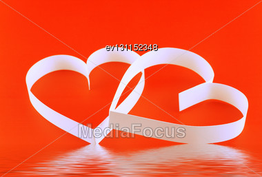 St. Valentine Day. Two Hearts,on Red Background Stock Photo