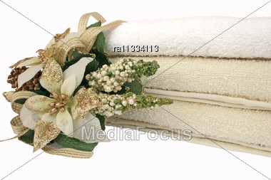 Stack Of Clean And Colorful Towels With Flowers Isolated On The White. Stock Photo