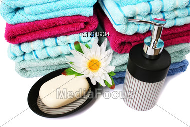 Stack Of Towels, Soaps And Flowers Stock Photo