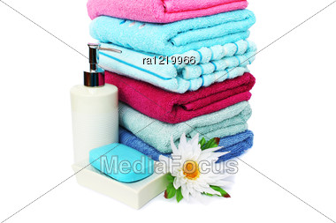 Stack Of Towels, Soaps And Flowers Isolated On White Background. Stock Photo