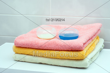 Stack Of Towels With Washing Gel In Containers On The Top Stock Photo
