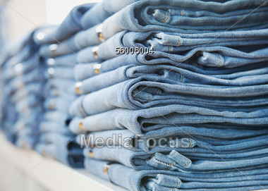 Stacked Denim Jeans In Boutique Stock Photo