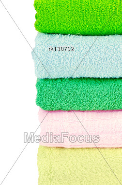 Stacked Towels Green, Blue, Pink And Yellow Color Stock Photo